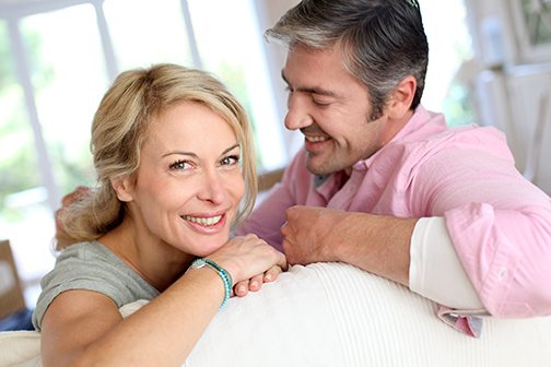 middle aged couple relaxing at home after solving erectile dysfunction